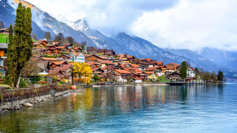 Old town and Alps mountains on Brienzer Lake, Switzerland