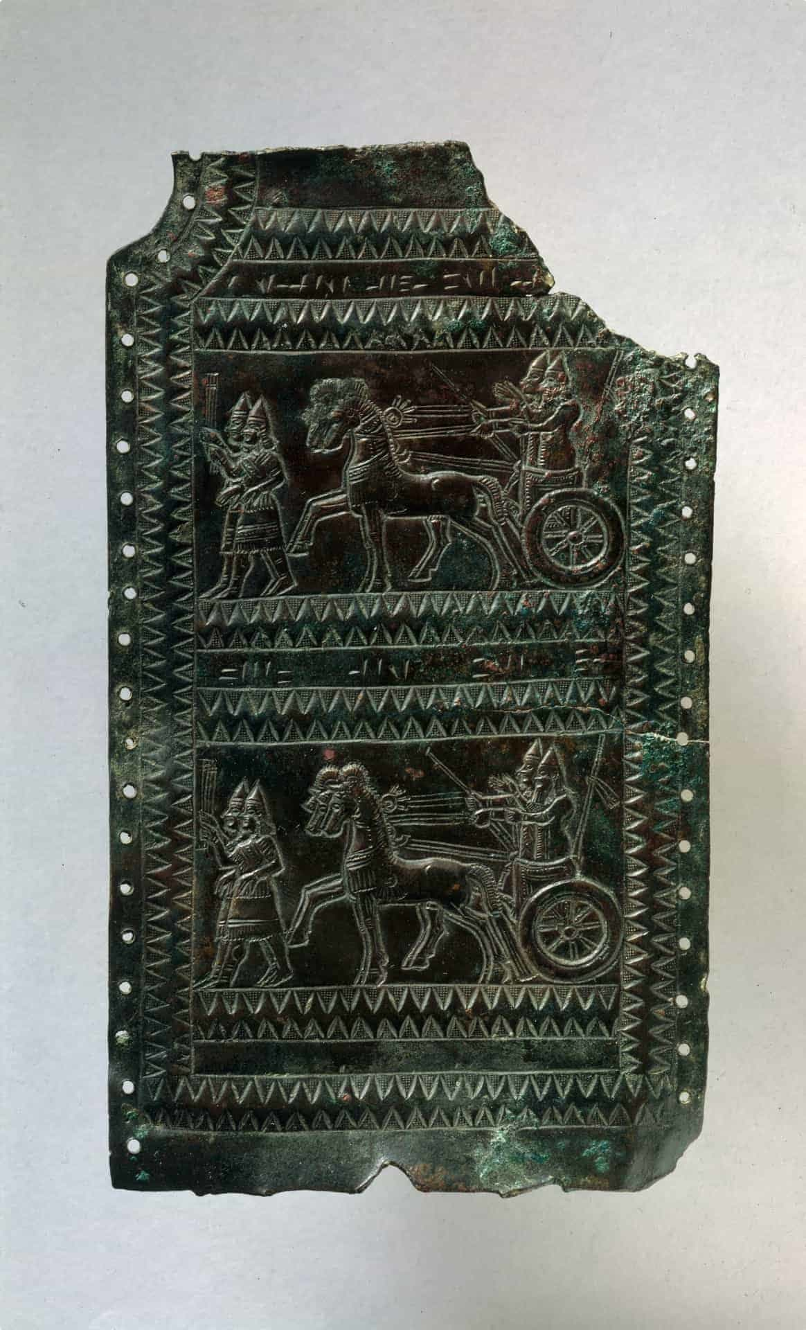 """Plaque fragment with chariot scenes inscribed with the Urartian royal name Argishti. <a href=""""https://www.metmuseum.org/art/collection/search/326172"""">Courtesy Metropolitan Museum of Art.</a>"""