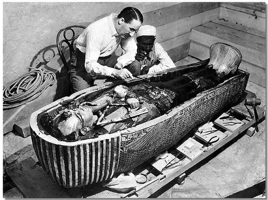 Howard Carter examines King Tutankhamen's mummy