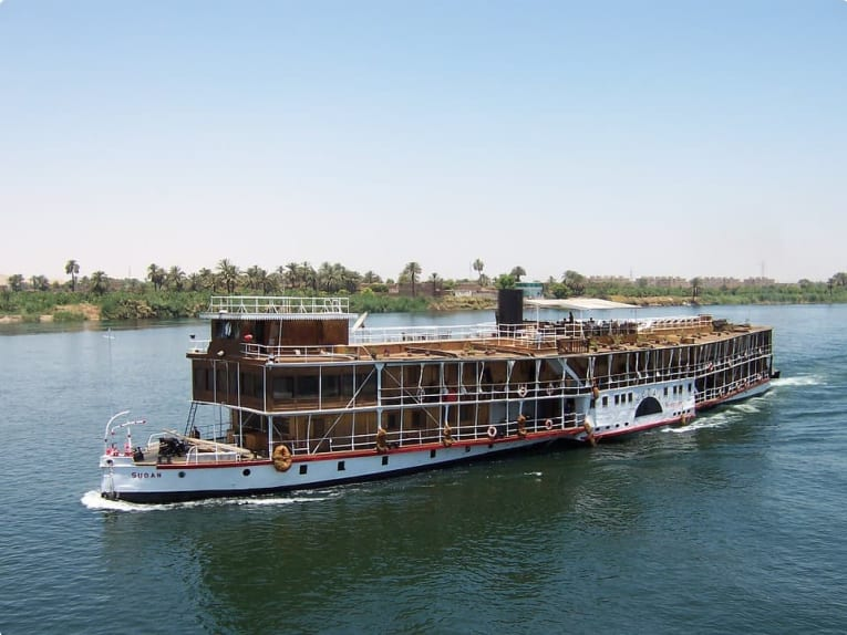 A boat cruises down the Nile