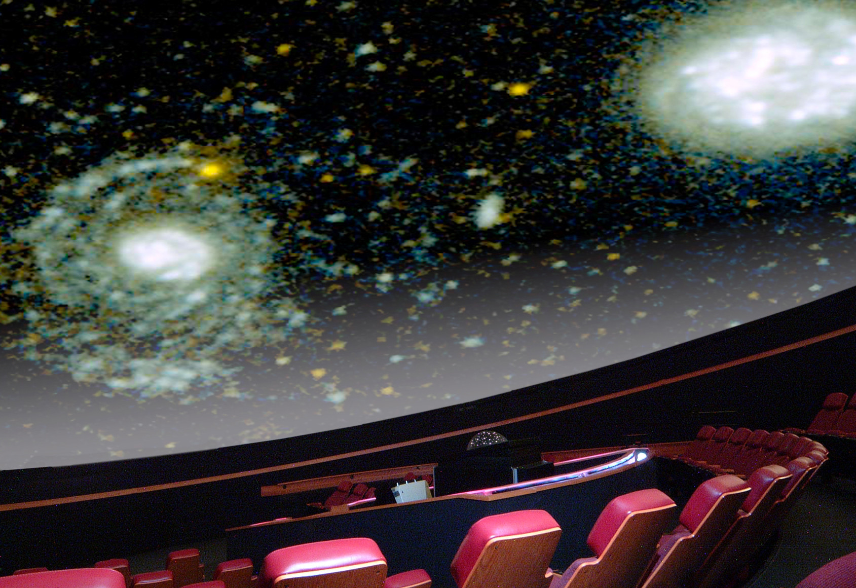 Palnetarium auditorium with stars projected on the ceiling
