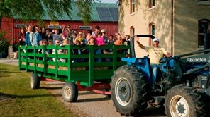 Tractor and hay wagon full of people on a hayride