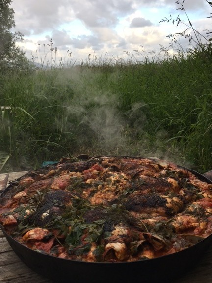 Paella over an open fire at China Beach Retreat