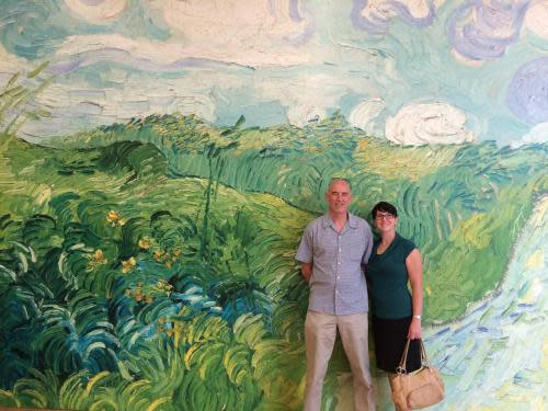 Photo of a huge Vincent Van Gogh painting with two people standing in front of it.  It is from the Van Gogh exhibit at the Clark.