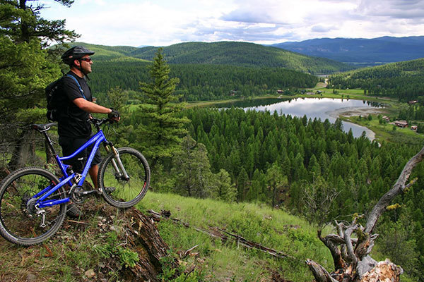 Stay at Kandahar Lodge and mountain bike Whitefish and Glacier National Park trails
