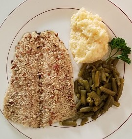 Pecan Crusted trout with green beans and cheesy grits
