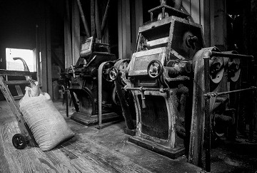 Old black and white image of mill grinders and sorters
