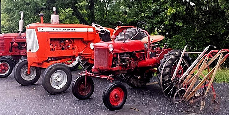 old red tractors and plows
