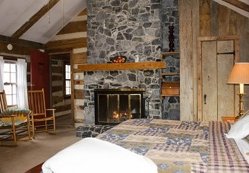 Lodge Room with king bed and fire in fireplace