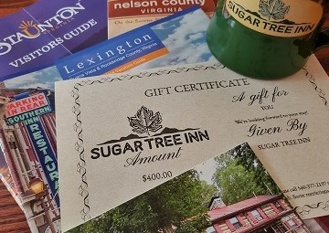 A top shot of a Sugar Tree Inn Gift Certificate on top of Lexington, Staunton, and Nelson Country Guides