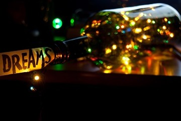 Blurred colored lights in wine bottle with Dream tag