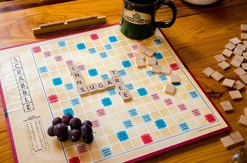 Scrabble Board Game with Sugar Tree Inn on board