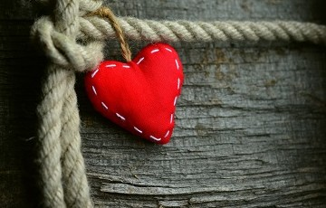 Knotted rope with a red heart attached