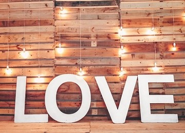 Love sign against wood pallet backdrop