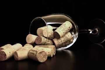 Corks spilling out of a falled wine glass