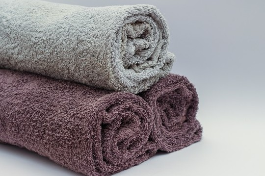 Three towels rolled up in pyramid style