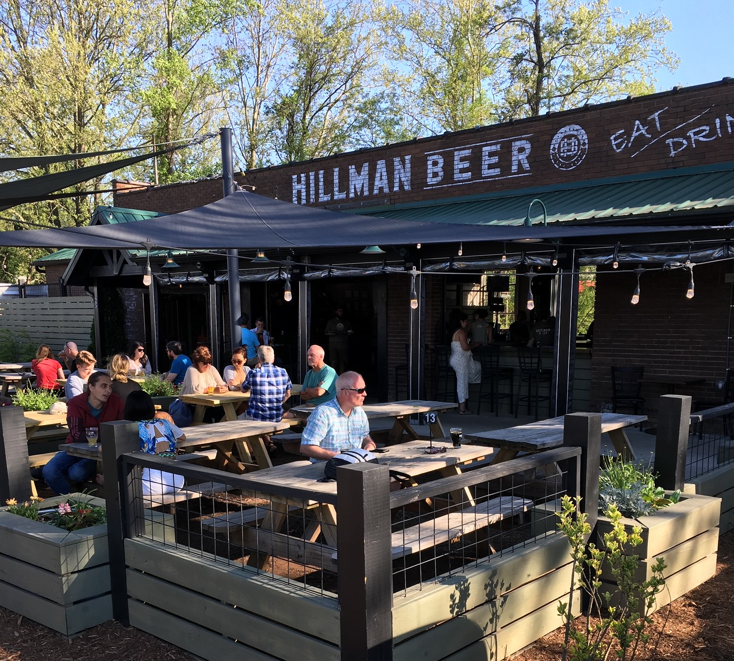 Hillman Beer location with picnic tables on patio