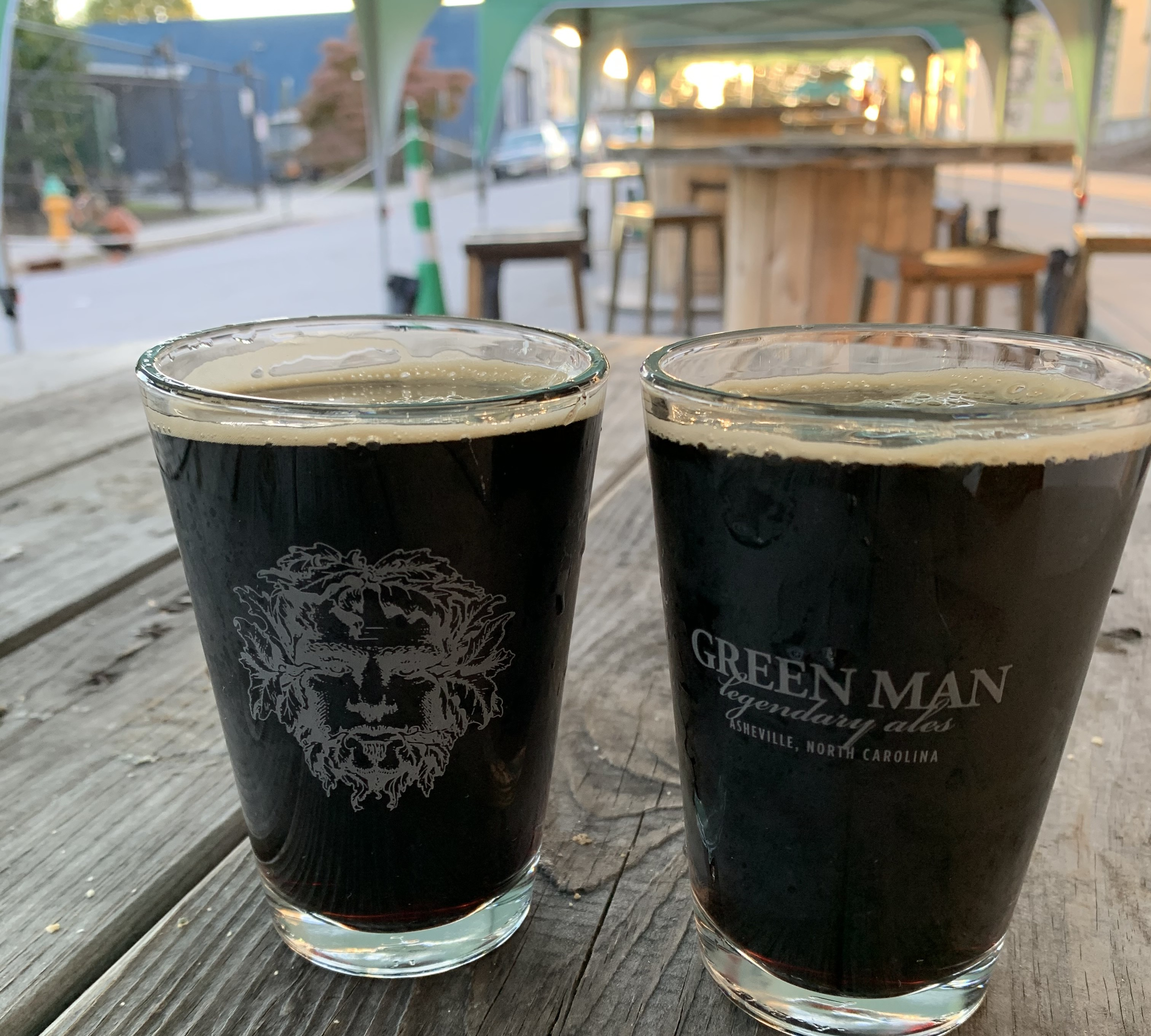two half pints of dark beer on outside table at Green Man