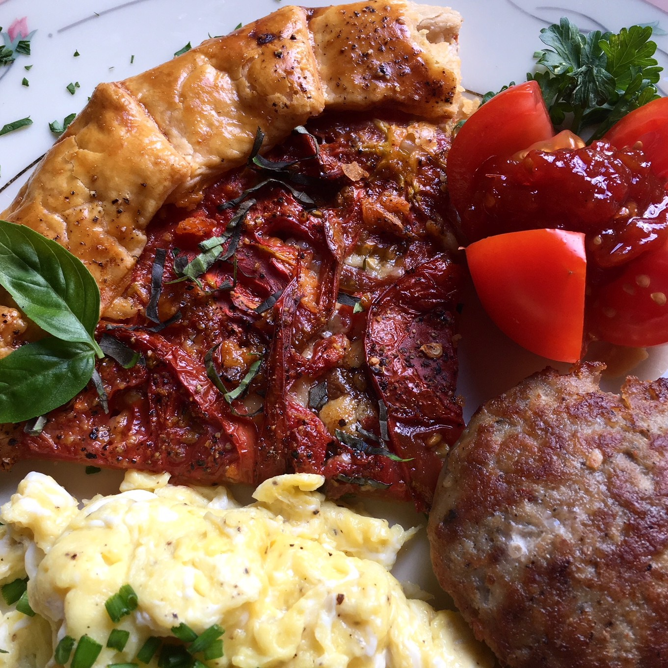 breakfast plate with tomato galette and jam
