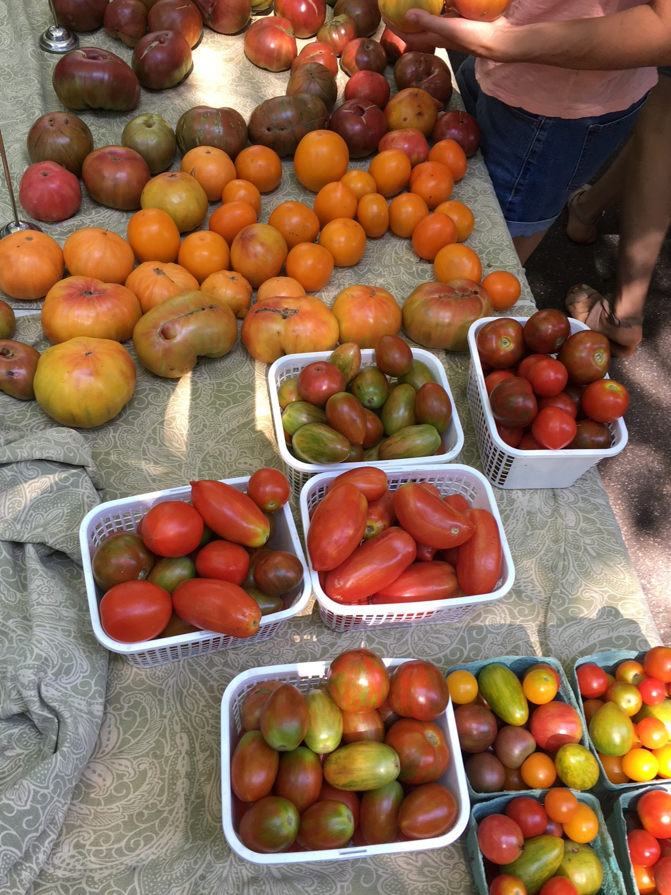 table full of tomatoes at farmers market