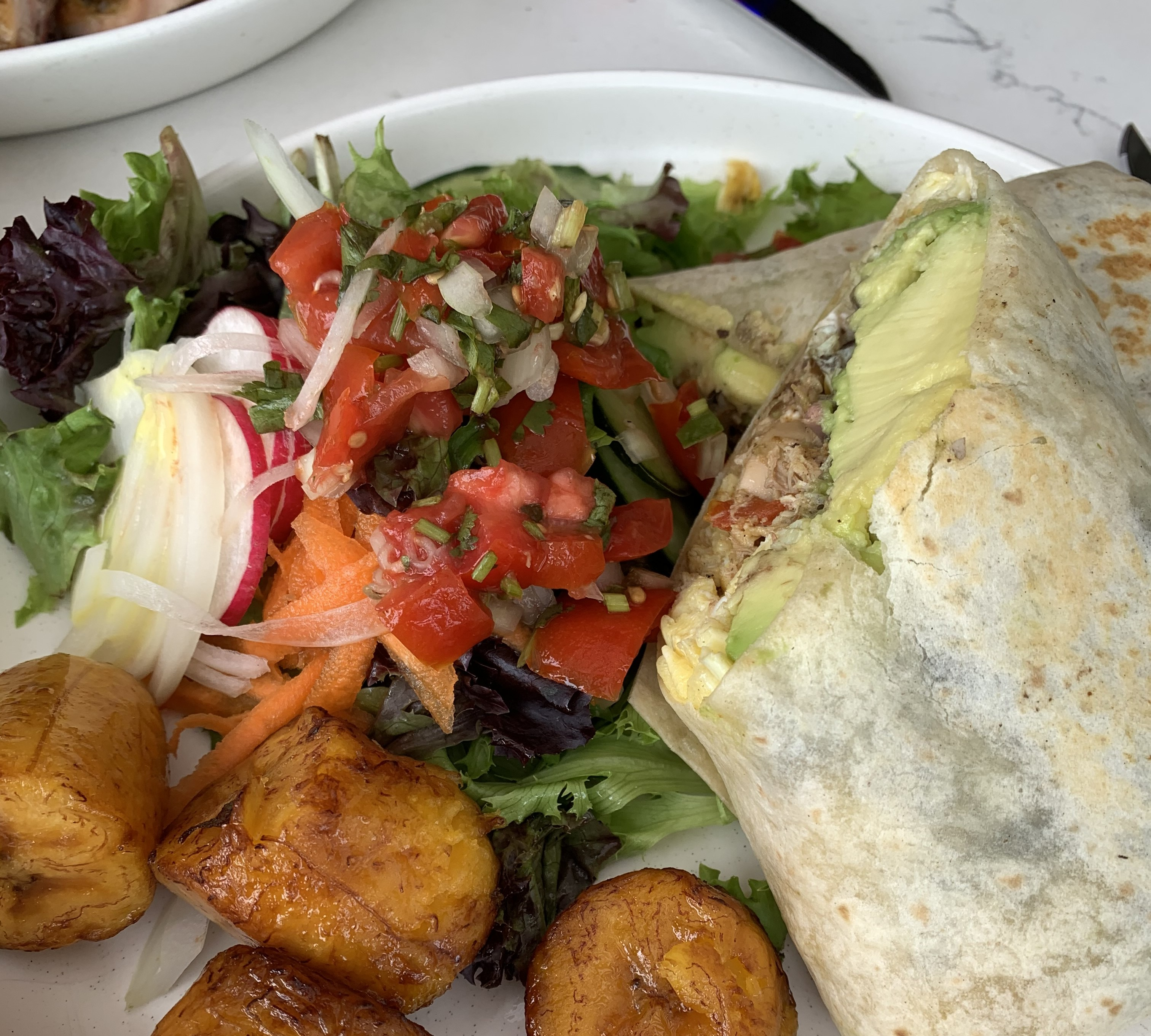 Bomba chicken roll with salad and plantians