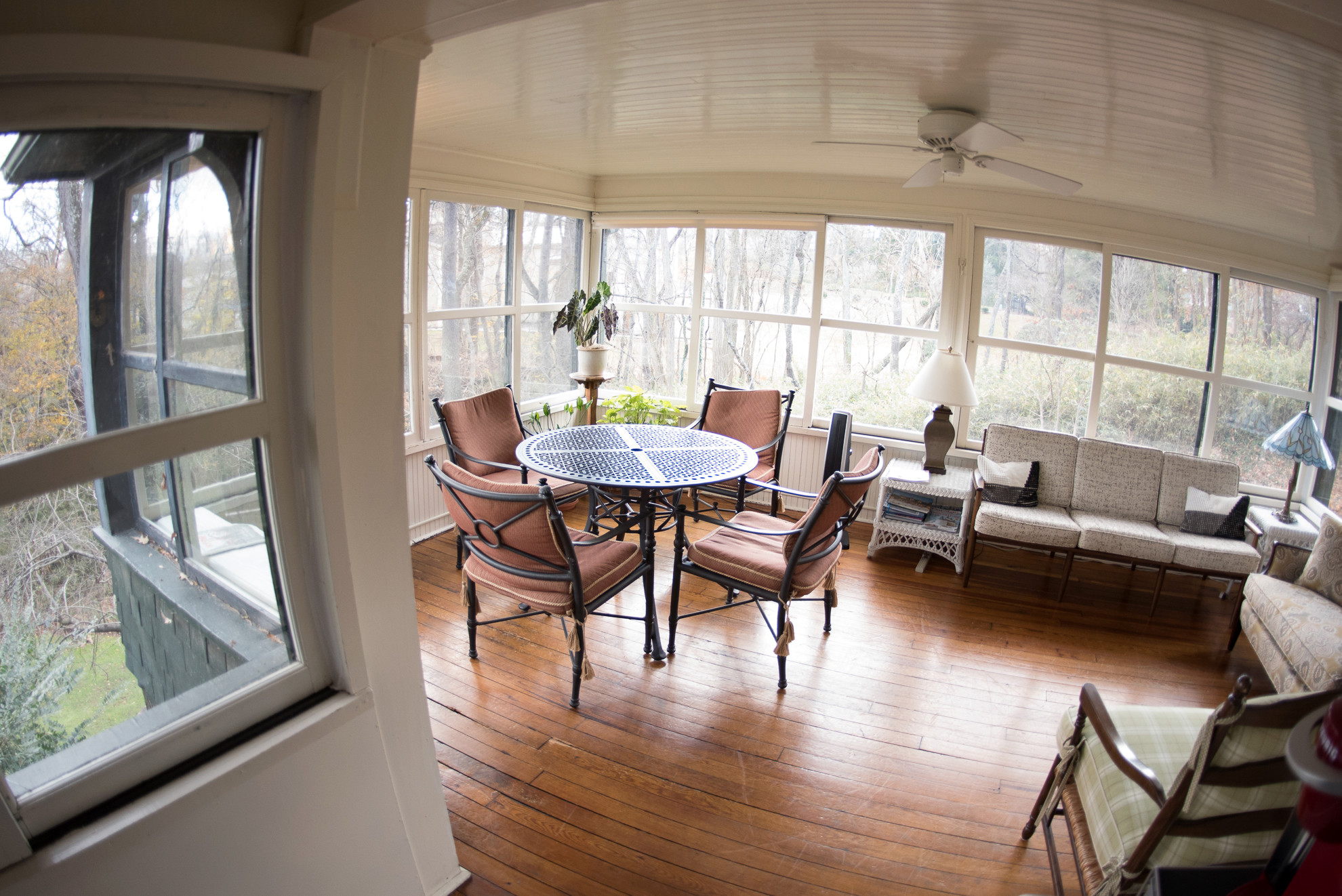 sun porch at Pinecrest with table and chairs
