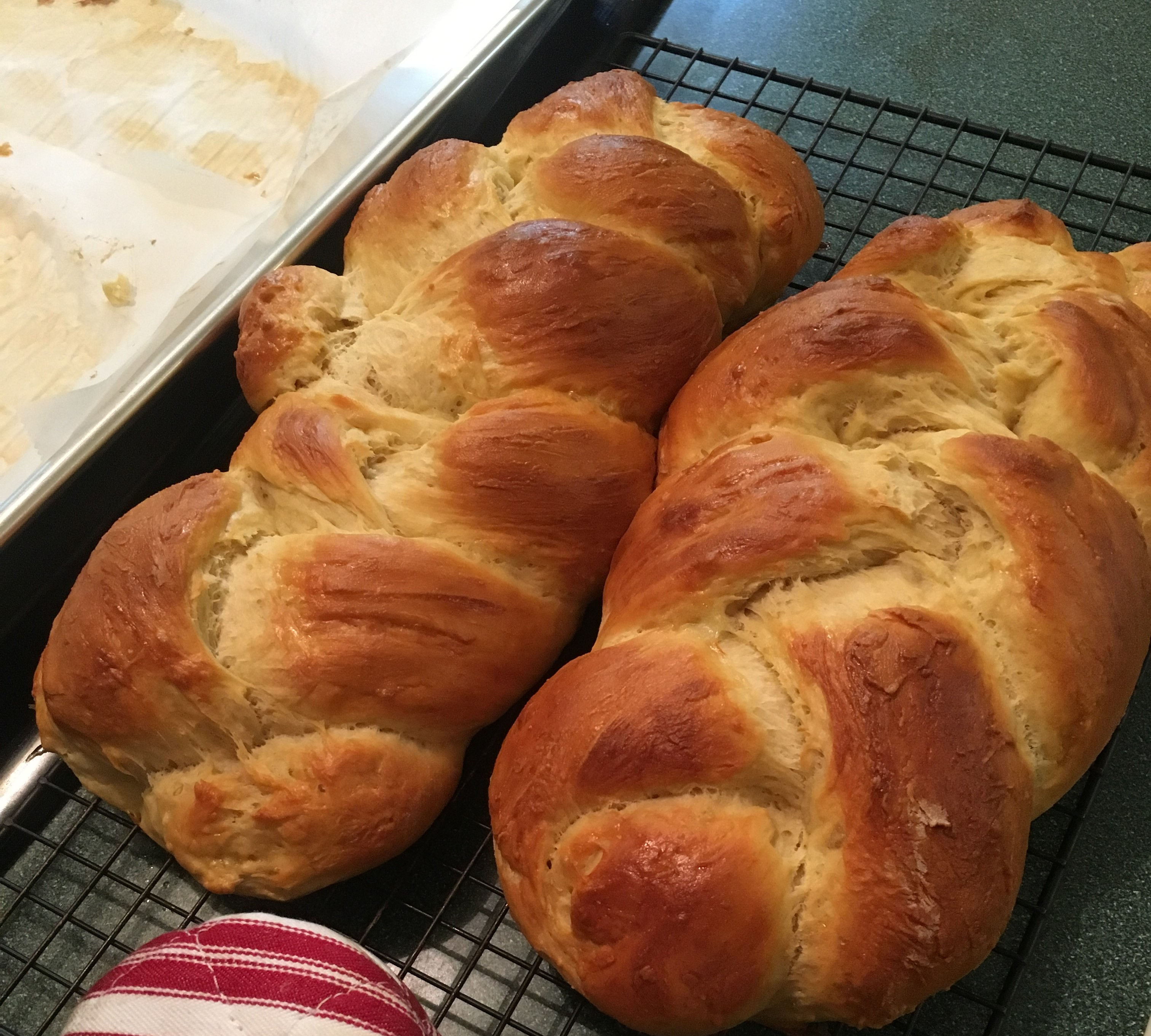 two loaves of fresh baked challah bread