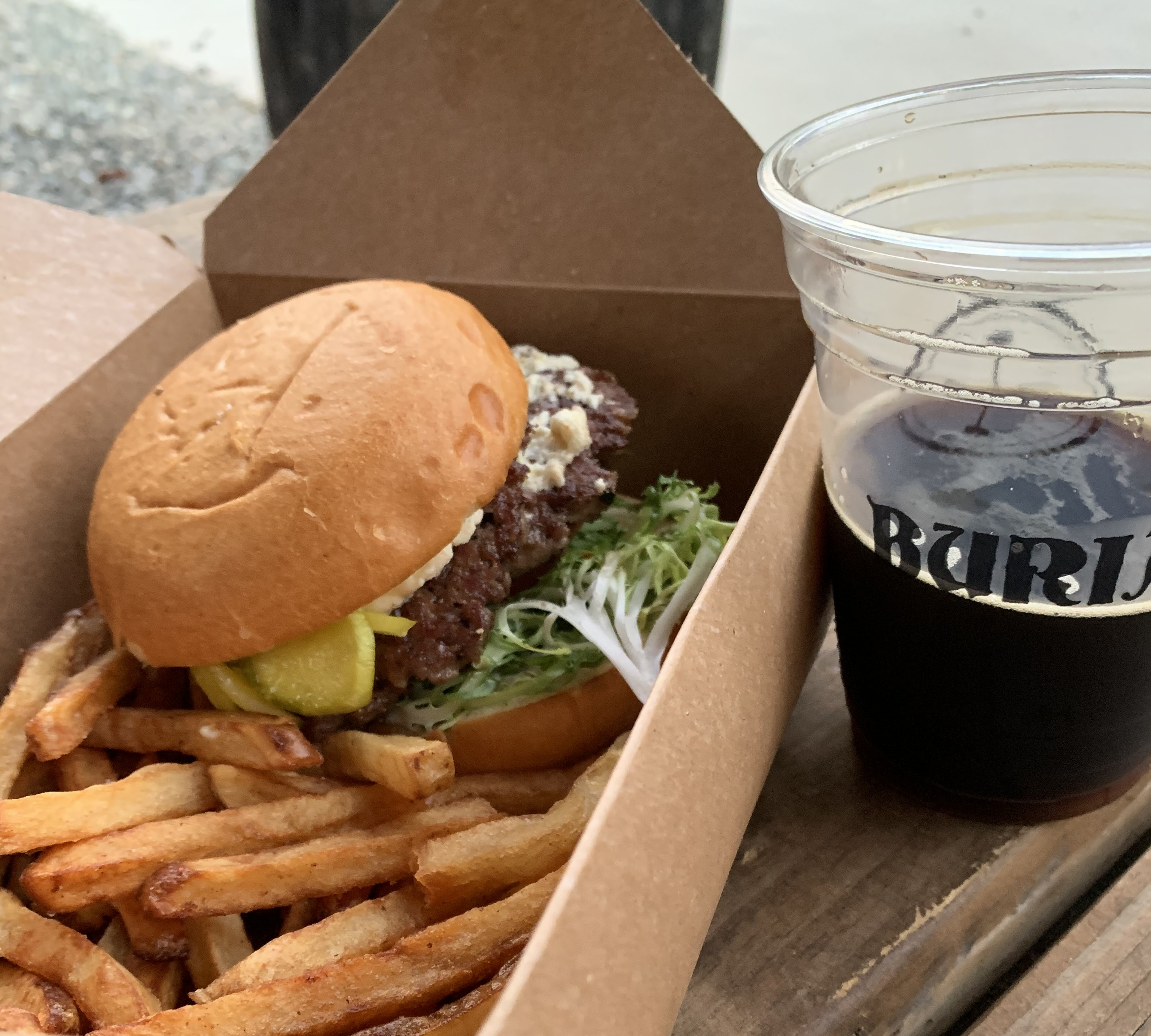 buger and fries with beer from Burial Beer co