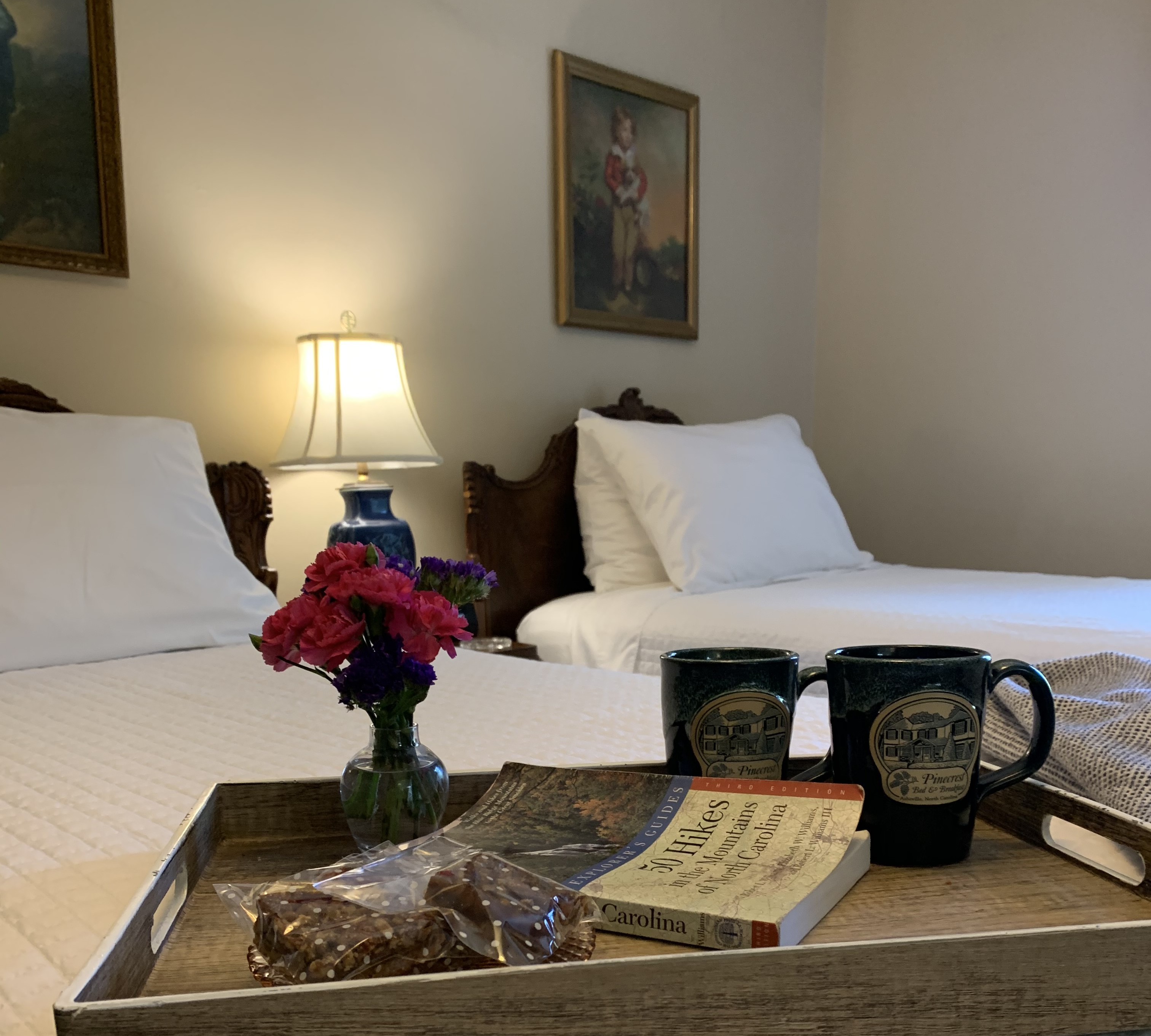 tray on bed with books and mugs