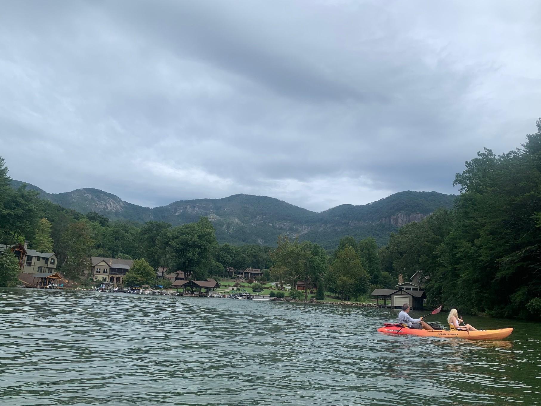 tandem kayak on Lake Lure with mountain views