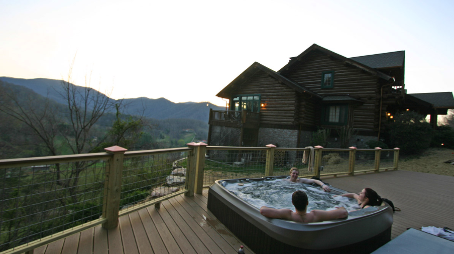 The outdoor jacuzzi at the Wildberry Lodge overlooks the mountain valleys.