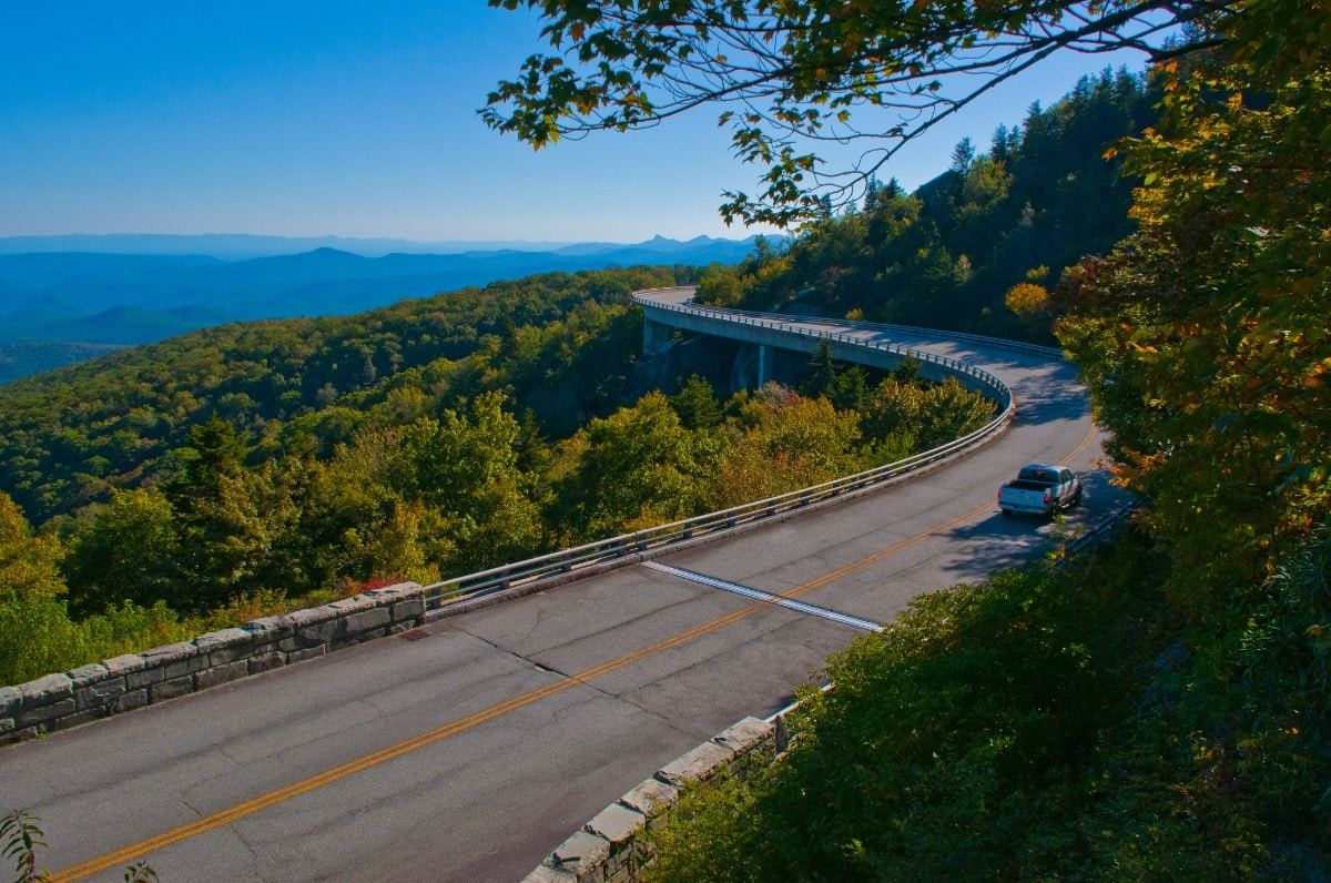 Blue Ridge Parkway with car driving on road, blue skies
