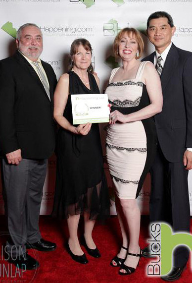 4 Innkeepers all dressed up and recieving an award for best B&B
