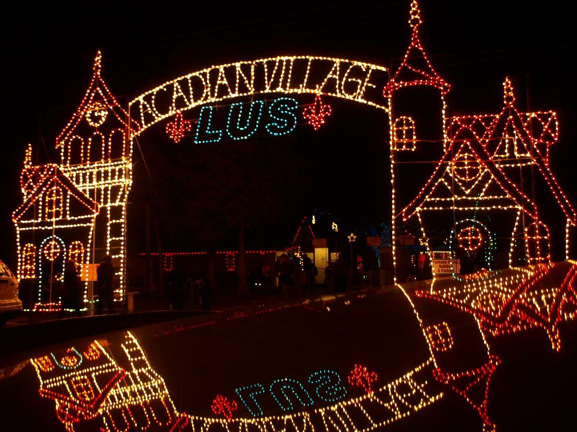 ... throughout the village, including a fully-lit chapel, animated displays, and spectacularly decorated Acadian home porches. At the Christmas carnival, ...