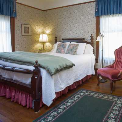 Deluxe King room with gas fireplace welsomes you~Asheville NC Bed and Breakfast Inn~1899 Wright Inn and Carriage House