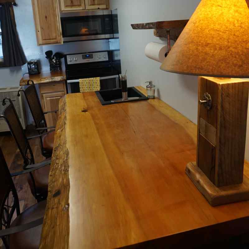Table/counter is nearly 8 feet long and 3 feet wide.