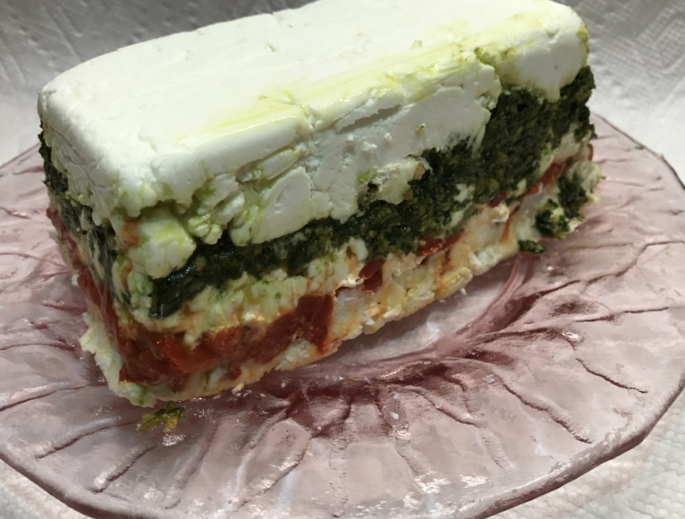 Goat Cheese Layered with pest and Roasted red Peppers