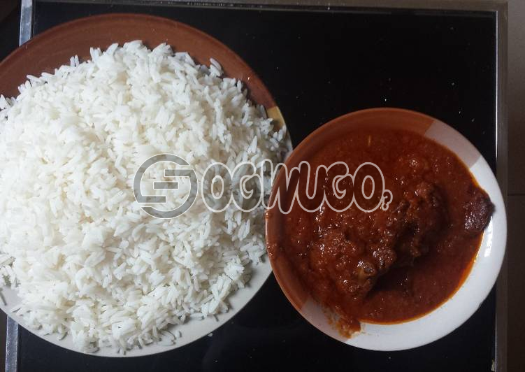 White rice and tomato stew with beef: Hot Deliciously Prepared White Rice and Tomato Stew with One meat. This product comes with free bottled water