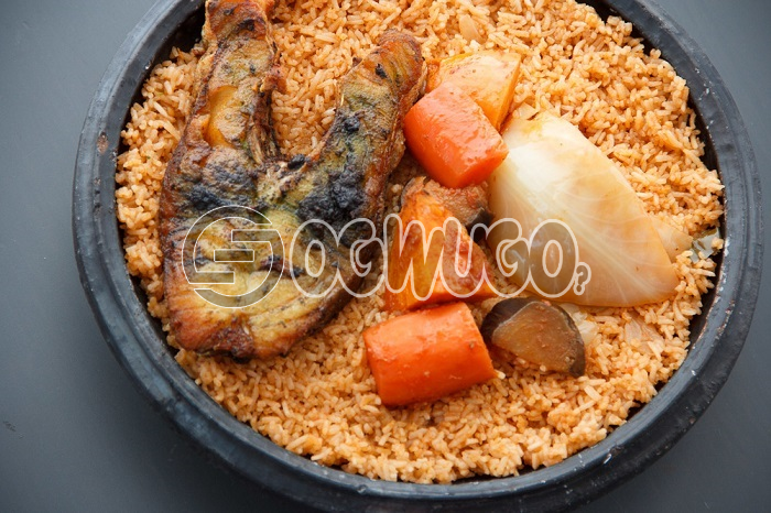 Hot Delicious savory Jollof Rice and FISH TAIL. The meal is very tasty just the way you like. Get free water when you order for this item: unable to load image