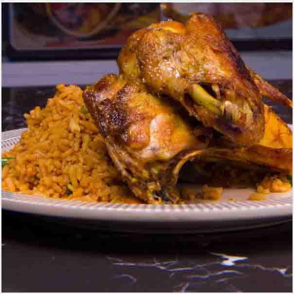 Hot Delicious savory Jollof Rice with Tasty Chicken Just the way you want it. Get free water when you order for this item: unable to load image