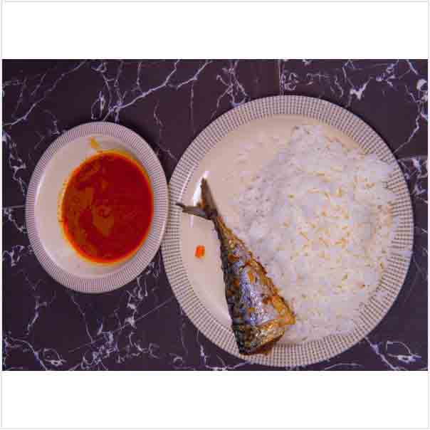 Tasty Delicious Hot White Rice and Stew With a well garnished Fish Tail. Get free water when you order for this item: unable to load image