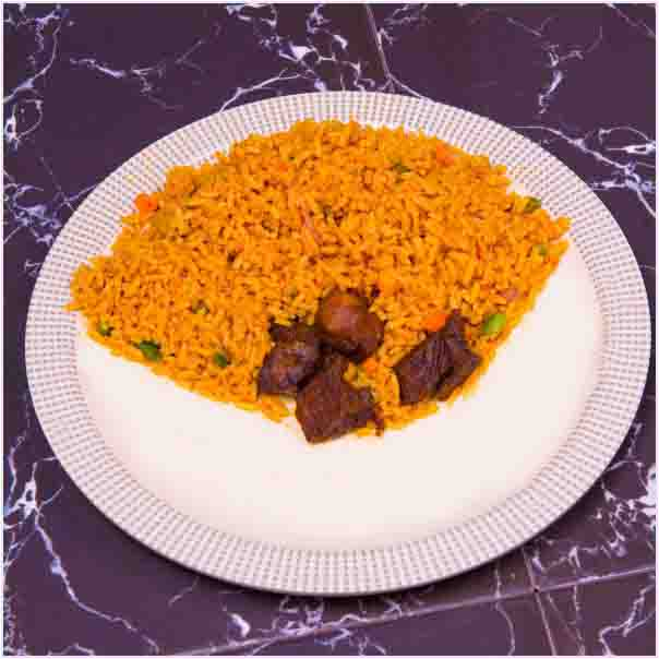 Hot Delicious savory Jollof Rice and Beef. It comes with well garnished beef Just the way you like. Get free water when you order for this item