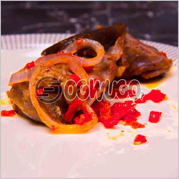 Single portion of tasty goat meat which is well sauced and garnished, ready to keep your taste buds
