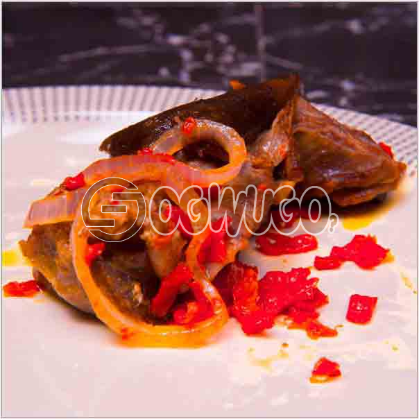 Single portion of tasty goat meat which is well sauced and garnished, ready to keep your taste buds: unable to load image