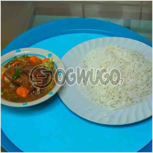 White rice and Chicken Sauce: A plate of Delicious Hot white rice with chicken sauce which can be enjoyed anytime of the day: unable to load image