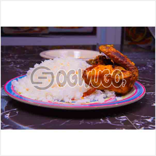 Tasty Delicious Hot White Rice and tomato stew or Ofe akwu stew With a well garnished chicken.