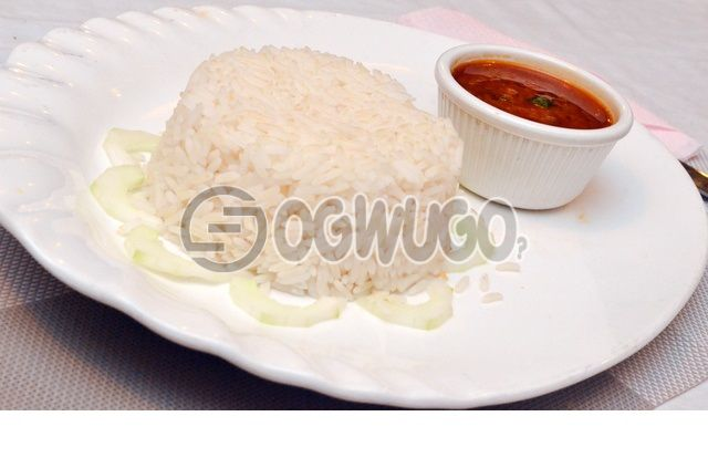 White rice and tomato stew or Ofeakwu stew with One big Beef, or Goat meat or Gizzard. This meal is very delicious and mouthwatering, please select your meat type and stew type