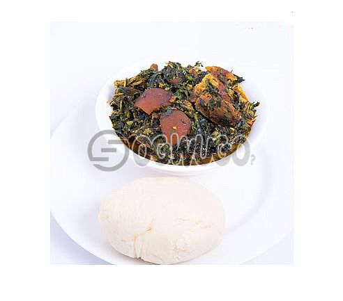 Vegetable soup with hot Pounded Yam swallow Freshly made and very nutritious to the body.