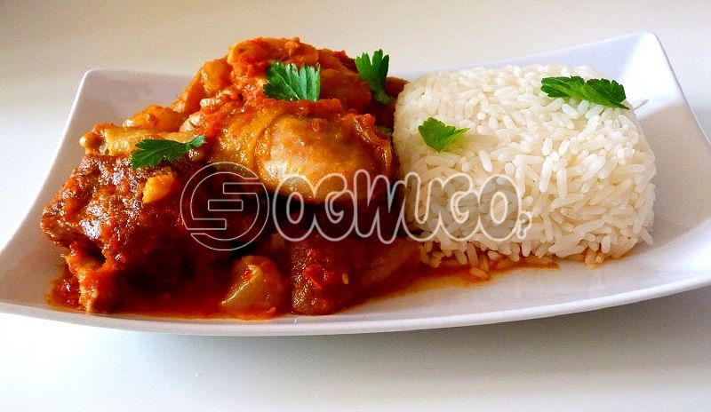 Tasty Delicious Hot White Rice and tomato stew With  well garnished Chicken.