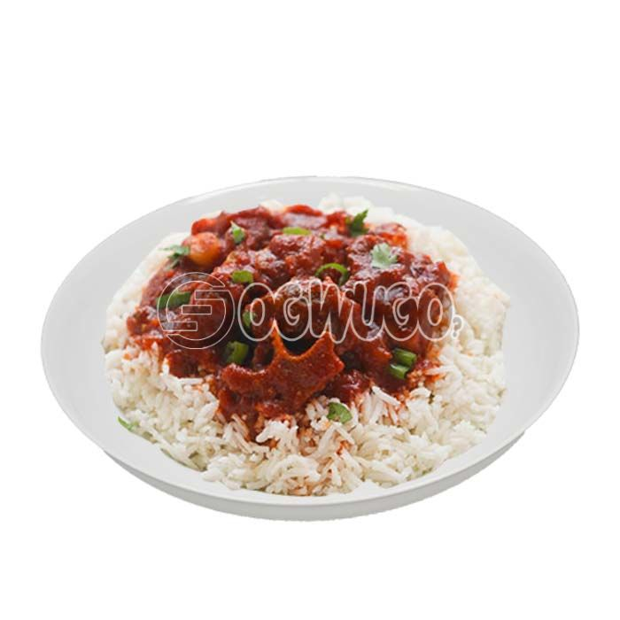 Hot delicious and tasty white Rice and Stew with two pieces of beef.